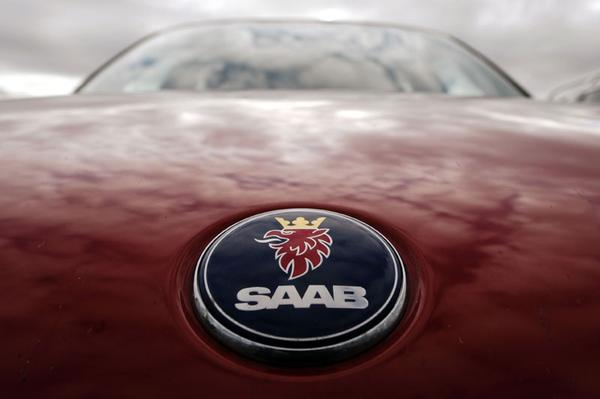 Saab bij de fabriek in Trollh�ttan | Foto: ANP/AFP