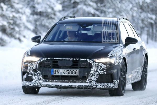 Audi A6 Allroad kruipt door de sneeuw
