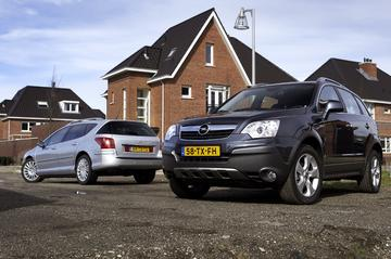 Opel Antara 3.2 Cosmo-Peugeot 407 SW 3.0 Féline